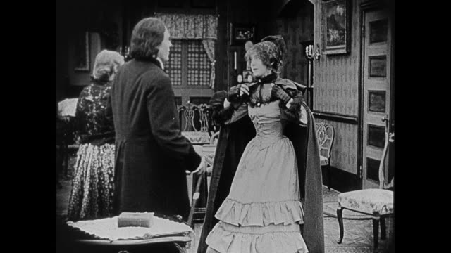 1860s a woman (lillian gish) and her father (ralph lewis) say their goodbyes and leave their house - neunzehntes jahrhundert stock-videos und b-roll-filmmaterial