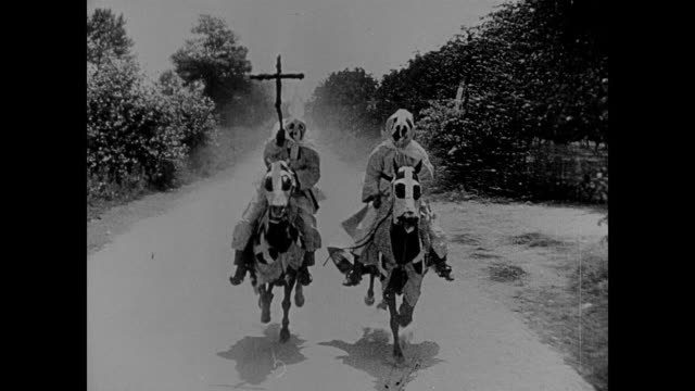 1860s ku klux klan members ride horses through town - ku klux klan stock videos and b-roll footage