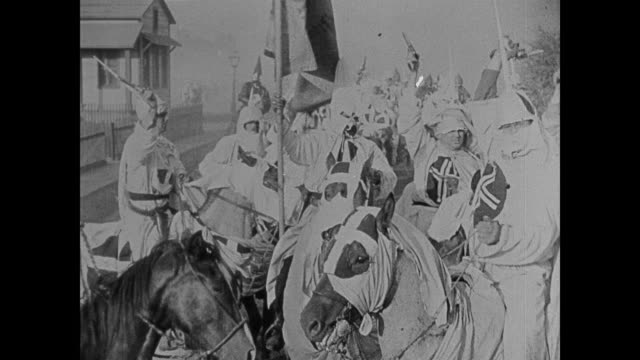 1860s the ku klux klan ride through town on horseback wielding guns - confederate flag stock videos and b-roll footage