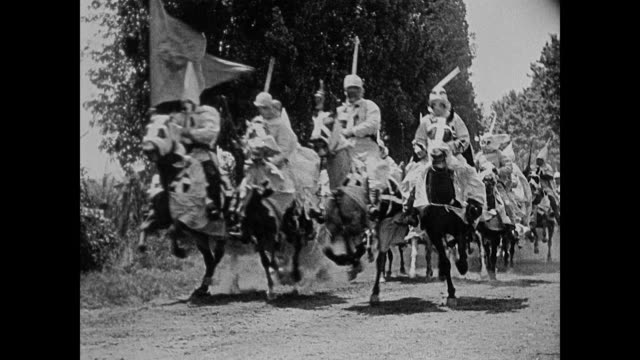 1860s ku klux klan ride horses down a dirt road - ku klux klan stock videos and b-roll footage