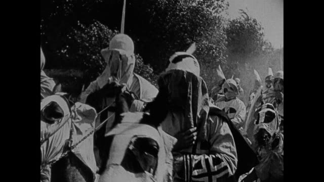 1860s ku klux klan members put on their masks while riding horses - ku klux klan stock videos and b-roll footage