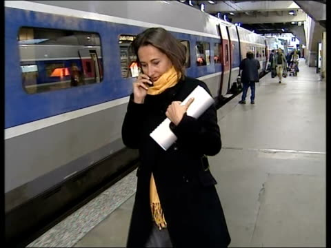 segolene royal could become first female president of france; paris: royal with mobile phone in eurostar terminal - president of france stock videos & royalty-free footage
