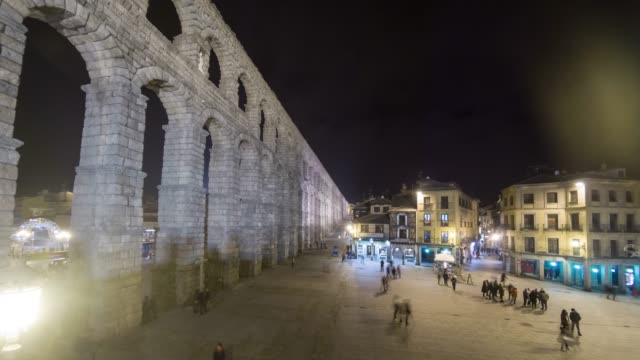 segovia spain aqueduct at night timelapse in winter with central square - segovia stock videos & royalty-free footage