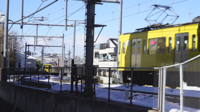 seibu ikebukuro line runs on among the residential district in ikebukuro at toshima ward tokyo japan on jan. 01 26. - elevated train stock videos & royalty-free footage