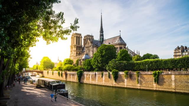 seine and notre dame de paris, paris, france - notre dame de paris stock videos and b-roll footage