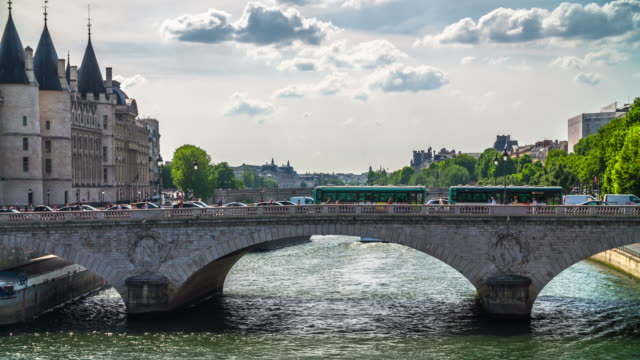 seine river and pont au change in paris, france - arch bridge stock videos and b-roll footage