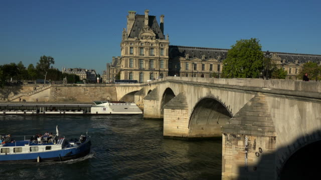 seine river, pont royal and louvre, paris, france, europe - brücke stock-videos und b-roll-filmmaterial