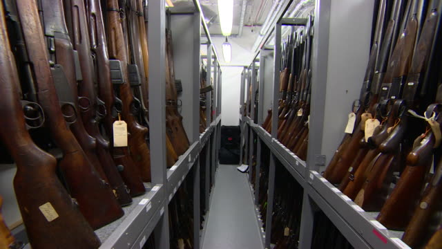 seized guns stored in the metropolitan police forensic firearms unit - rifle stock videos & royalty-free footage