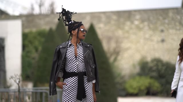 stockvideo's en b-roll-footage met selah marley wears a black leather jacket a checked outfit sunglasses outside dior during paris fashion week womenswear fall/winter 2018/2019 on... - zwart jak