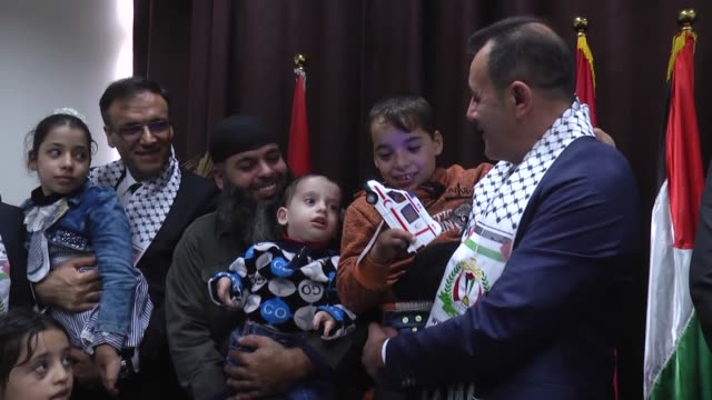 Selami Kilic head of international health policy at the Turkish Health Ministry meets with three Palestinian brothers born with congenital amputation...