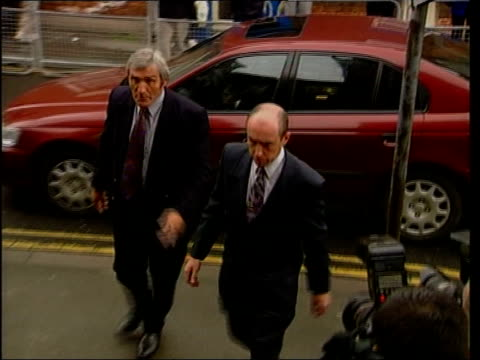 stockvideo's en b-roll-footage met hart appears in court anat gary hart into court building - gary w. hart