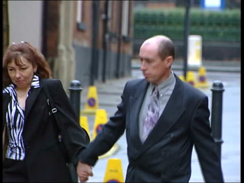 stockvideo's en b-roll-footage met u'lay england yorkshire leeds gary hart and wife elaine arriving at court for his trial in connection with the selby train crash - gary w. hart