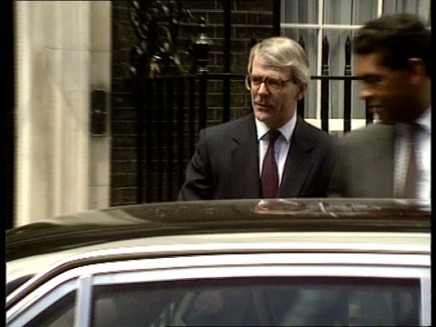 Commons clash US investigation ENGLAND London Downing St No 10 John Major out to car ZOOM IN MS Car along away