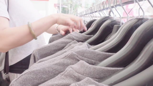 select shirt clothes - sale stock videos & royalty-free footage
