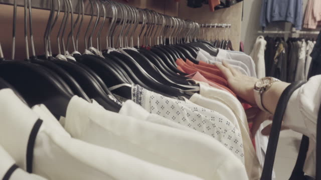 select shirt shopping - choosing stock videos & royalty-free footage
