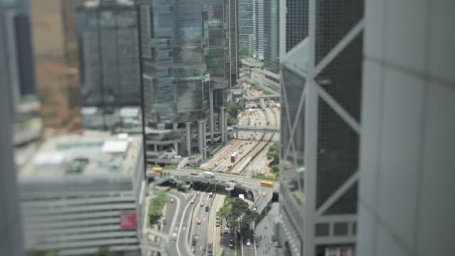 stockvideo's en b-roll-footage met tl selected focus of hong kong city shot from a skyscraper - hong kong