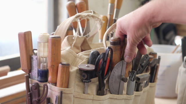 cu selecting a tool from a tool bag on workbench - workbench stock videos & royalty-free footage