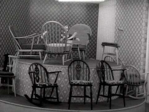 selection of dining chairs rotate on a display at the earls court furniture exhibition. - earls court stock videos & royalty-free footage