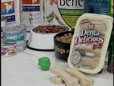 selection of light pet food suggests better nutrition for overweight pets. - overweight dog stock videos & royalty-free footage