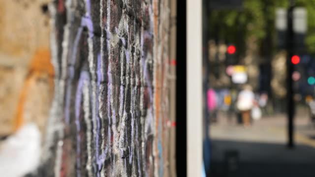 selective focus brick wall with street art - street style点の映像素材/bロール