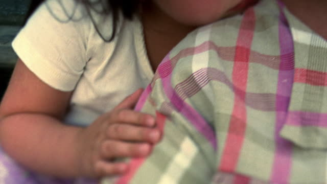 selective focus close up tilt up tilt down small girl rests head on middle aged woman's shoulder / nova scotia, canada - overweight child stock videos & royalty-free footage