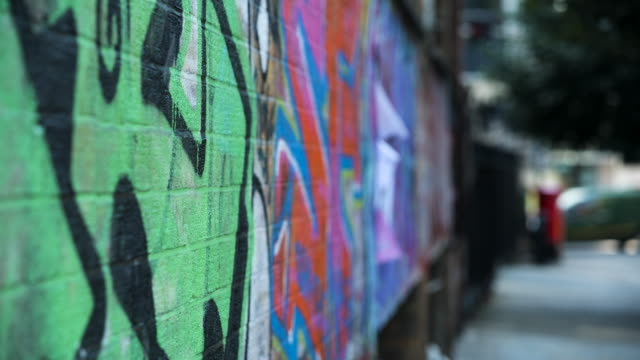 selective focus colourful graffiti - inquadratura fissa video stock e b–roll