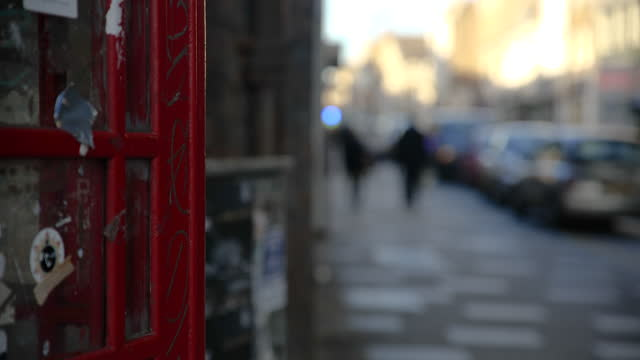 selective focus grimy red phone box on high street, london - soft focus stock videos & royalty-free footage