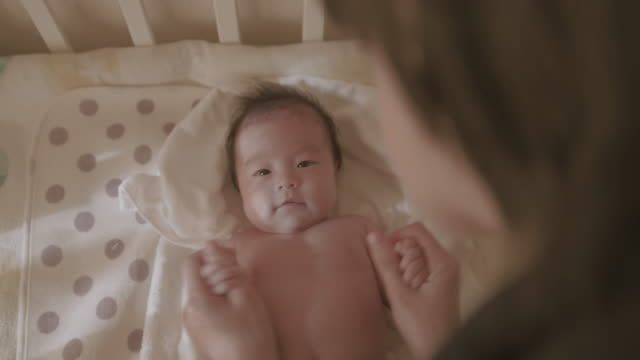 4K, Selective focus, Japanese baby(3month) and her mother.