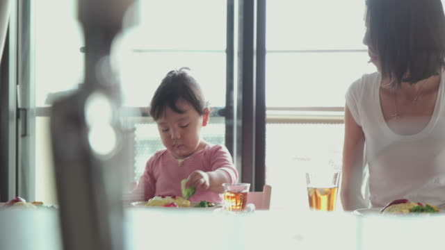 4k, selective focus. japanese family spending time together in their home. tokyo, japan - only japanese stock videos & royalty-free footage