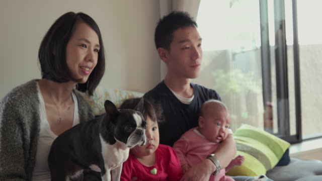 4K, Selective focus. Japanese family spending time together in their home. Tokyo, Japan