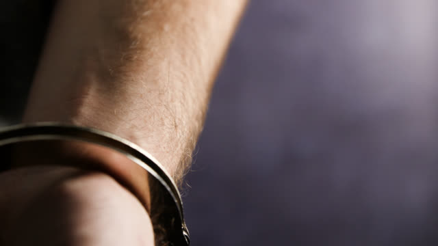cu selective focus man in handcuffs - male likeness stock videos & royalty-free footage