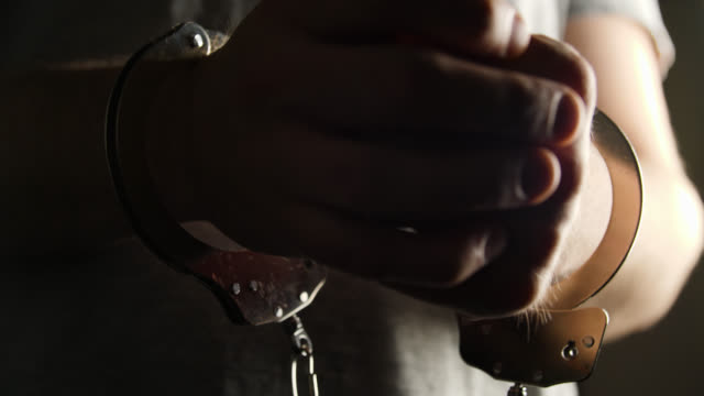 cu selective focus man in handcuffs - handcuffs stock videos & royalty-free footage