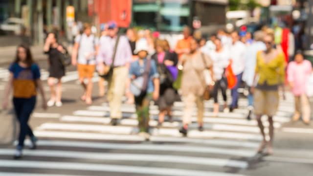 ms, selective focus, pedestrians crossing road at traffic light in manhattan - zebra crossing stock videos & royalty-free footage