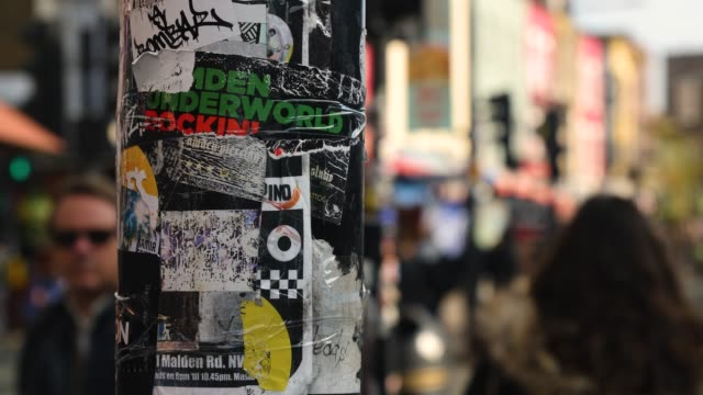 selective focus pillar covered in posters, camden high st - music poster stock videos & royalty-free footage
