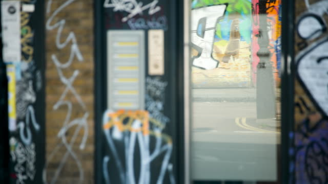 selective focus reflection of london street in window - graffiti stock videos & royalty-free footage