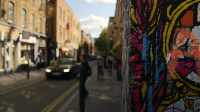 Selective focus shot of a colourful wall on Brick Lane
