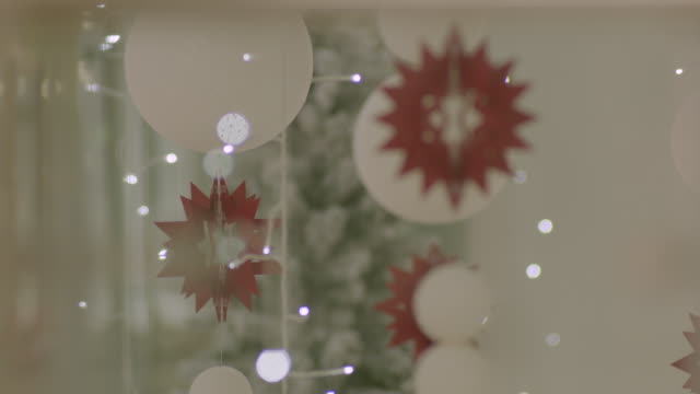 selective focus shot of christmas decorations hanging in a uk department store. - backgrounds stock videos & royalty-free footage