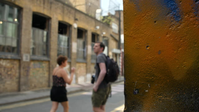selective focus tourists explore street art in shoreditch - see other clips from this shoot 281 stock videos & royalty-free footage