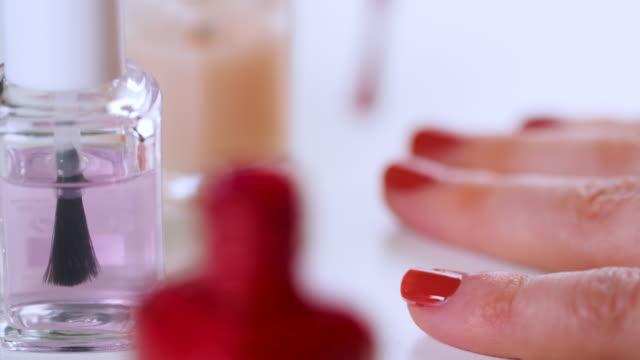 selective focus woman paints fingernails - femininity stock videos & royalty-free footage