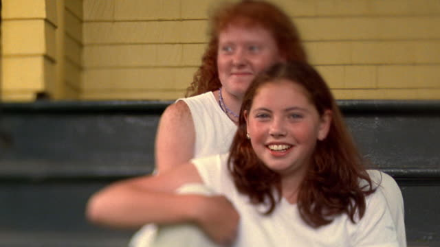 Selective Rack Focus Medium Shot Redheaded Girl And Teen Girl Sitting On Steps Laughing Nova Scotia Canada Stock Footage Video Getty Images