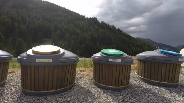 vídeos y material grabado en eventos de stock de selective underground sorting containers in mountain - contenedor para la basura