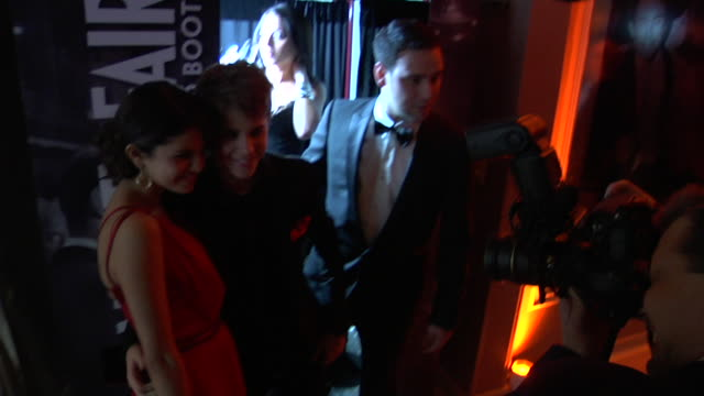 Selena Gomez and Justin Bieber at the 2011 Vanity Fair Oscar Party Inside at Hollywood CA