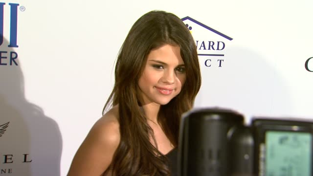 Selena Gomez at the Southern Style St Bernard Project Event With Ambassador Britney Spears at Beverly Hills CA