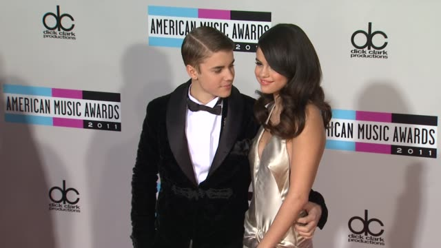 selena gomez justin bieber at the 2011 american music awards arrivals at los angeles ca - justin bieber stock videos & royalty-free footage