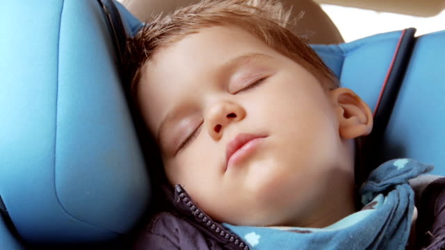 seleping baby in car seat - baby boys stock videos and b-roll footage