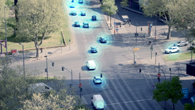 self driving autonomous cars on city street - traffic light stock videos & royalty-free footage