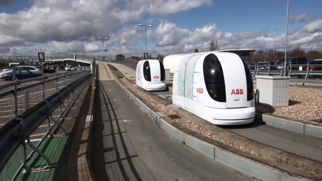 A self driving pod arrives at a car park at Heathrow airport in London UK on Tuesday March 29 2016 The logos of sponsor ABB Ltd sit on the interior...