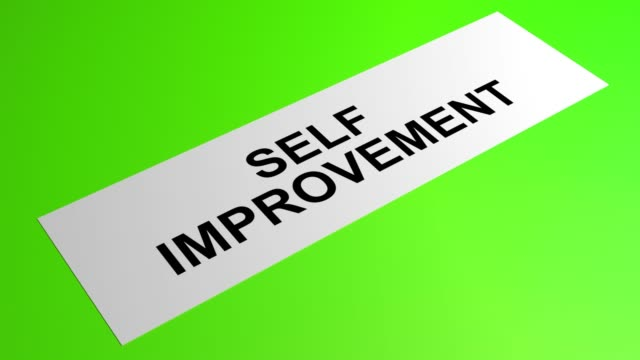 self improvement writing on a rolling green paper - self improvement stock videos & royalty-free footage