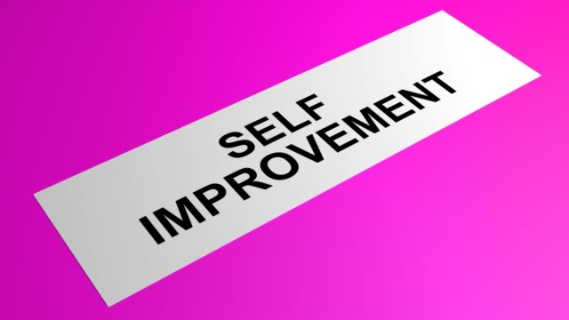 self improvement writing on a rolling pink paper - self improvement stock videos & royalty-free footage