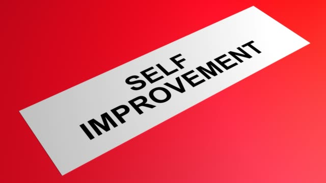 self improvement writing on a rolling red paper - self improvement stock videos & royalty-free footage